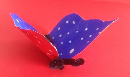 En dubbel fjäril i olika färger