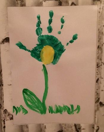 grön blomma av handtryck